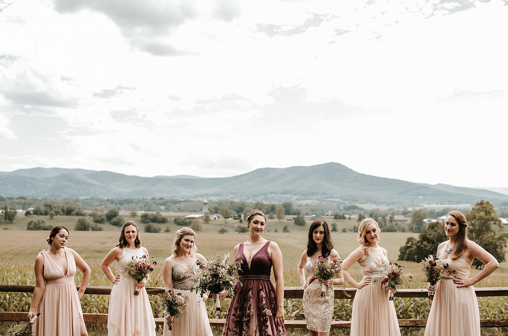 Bride and Bridesmaids posing with sass at The Pavilion Shenandoah Woods