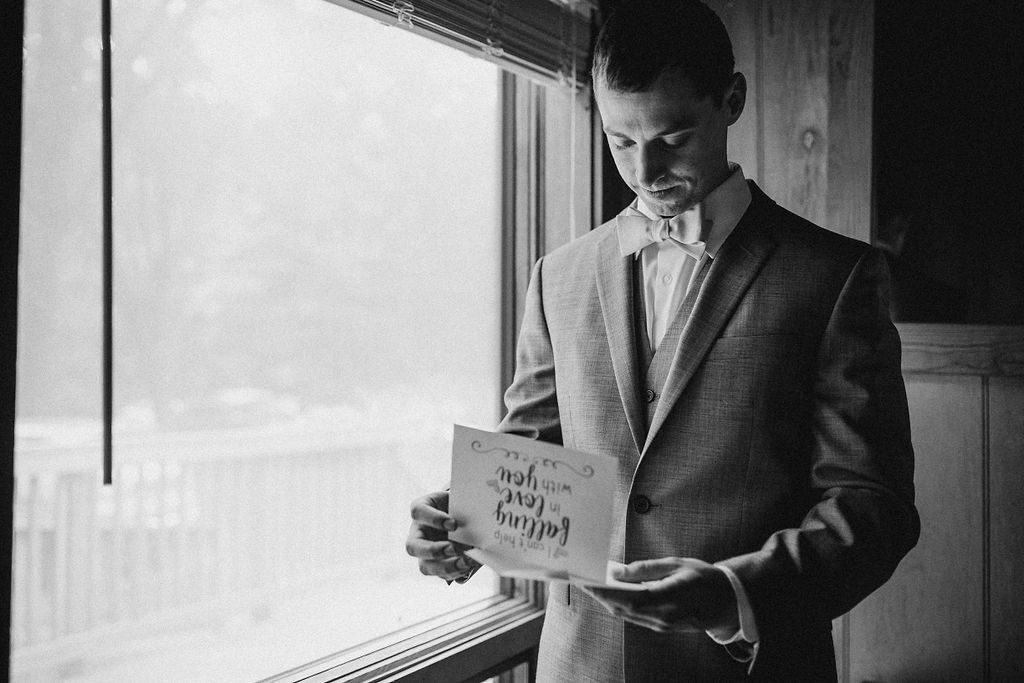 Groom Reading Letter from Bride at The Woodlands at Algonkian