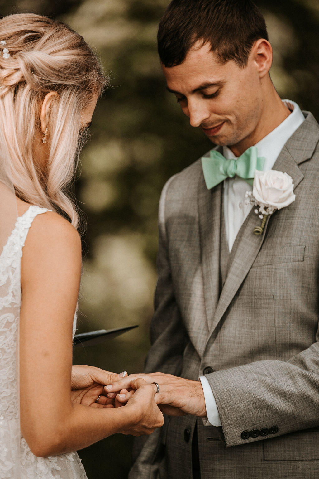 Bride and Groom Exchanging Rings at The Woodlands at Algonkian