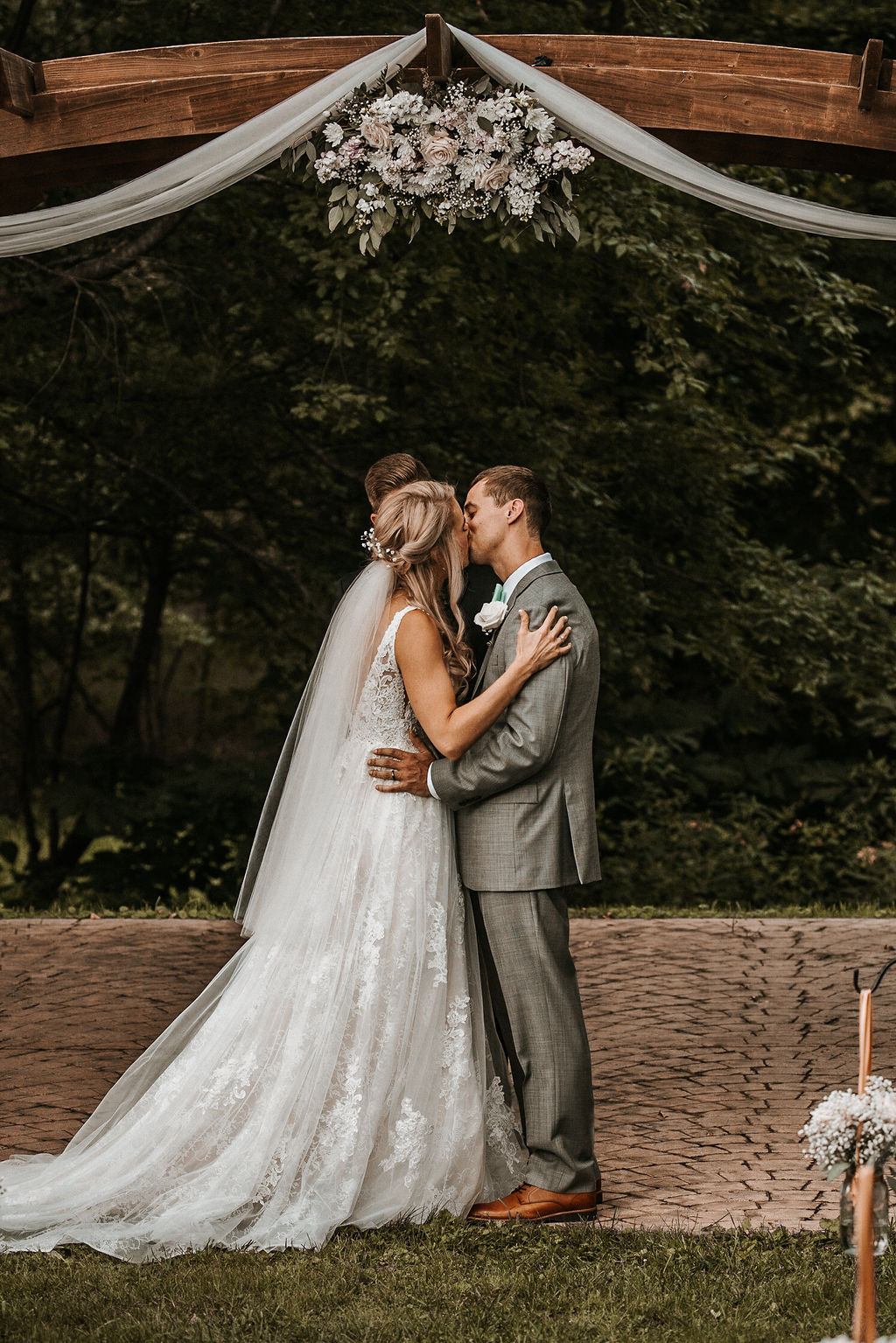 Bride and Groom Kissing at Alter at The Woodlands at Algonkian
