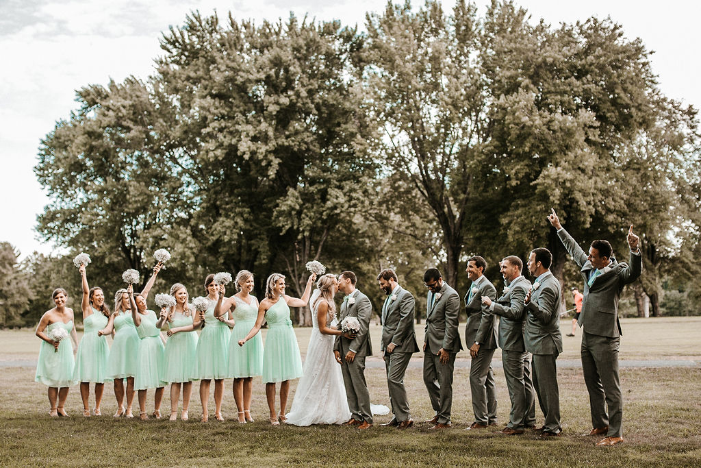 Wedding Party Cheering as Bride and groom kiss at The Woodlands at Algonkian