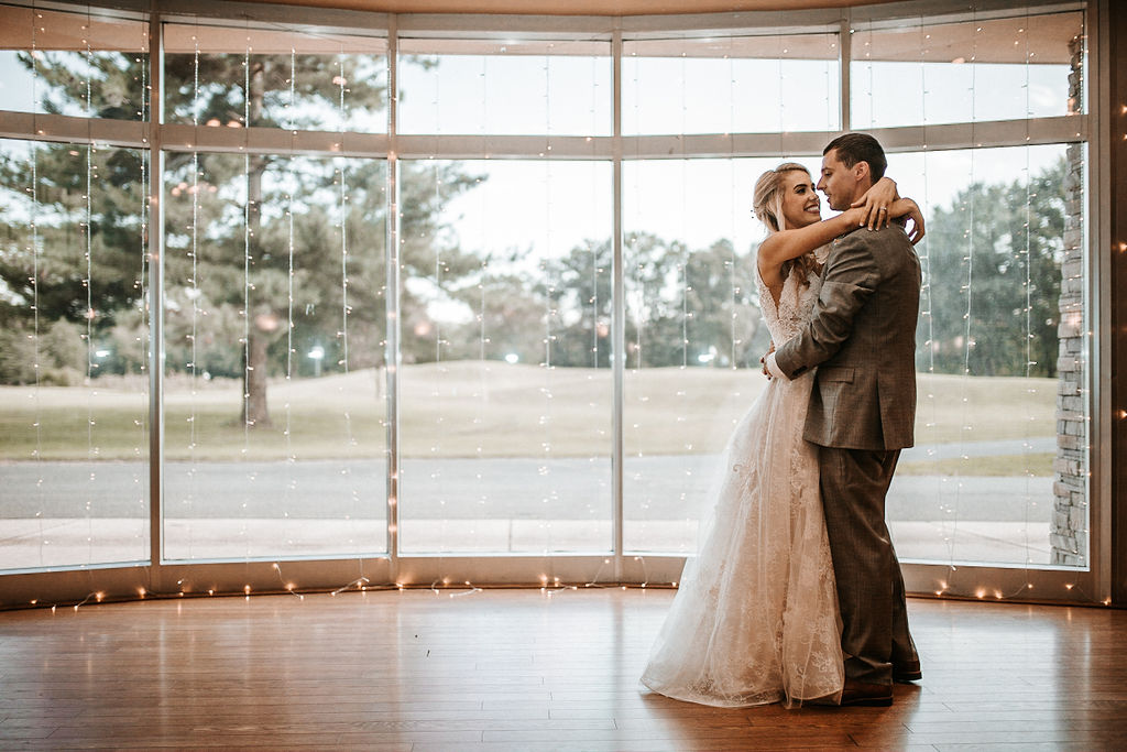 Bride and groom having first dance at The Woodlands at Algonkian