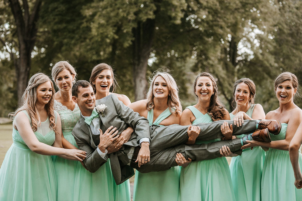 Groom Posing with Bridesmaids at The Woodlands at Algonkian