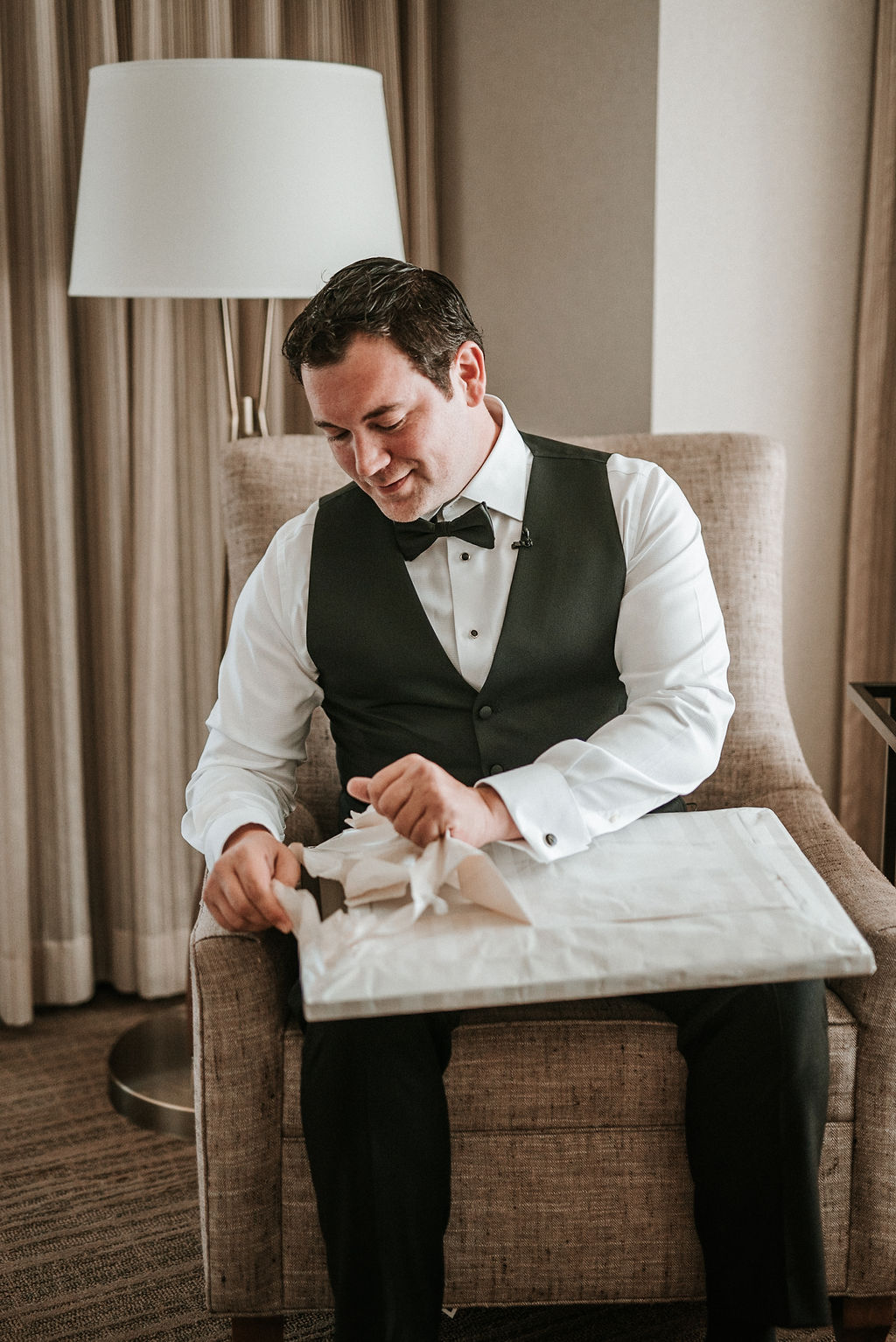 Groom opening gift from Bride at Bluemont Vineyard