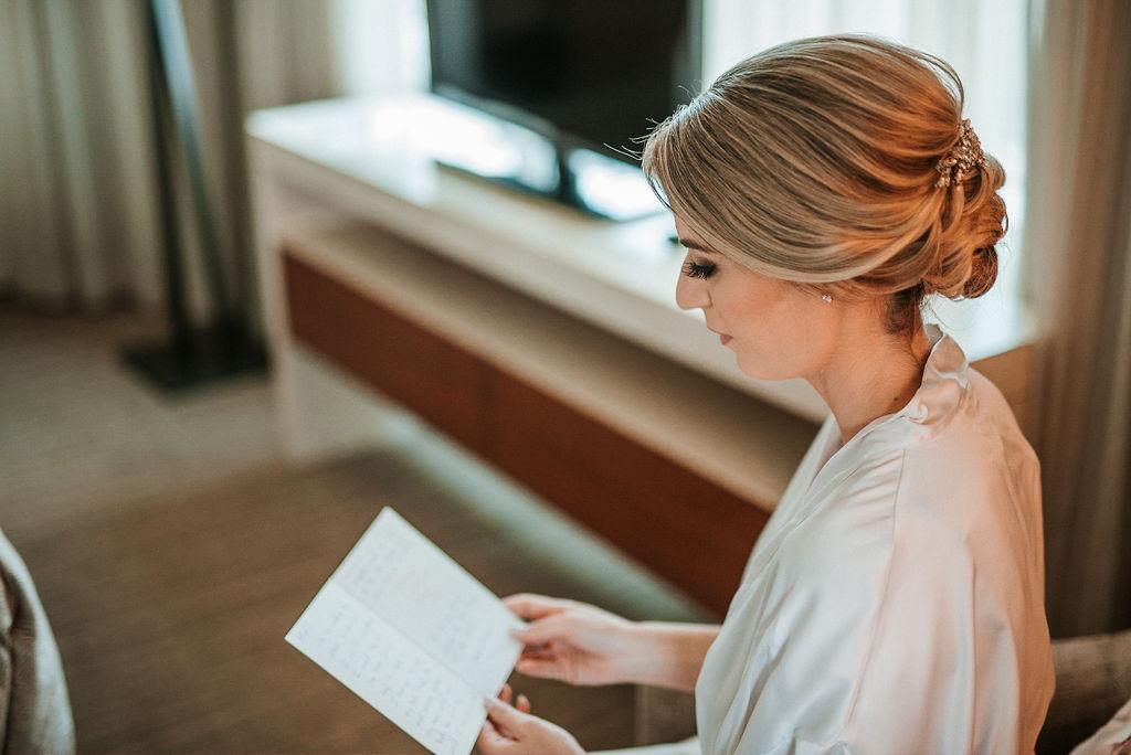 Bride reading letter from Groom at Bluemont Vineyard