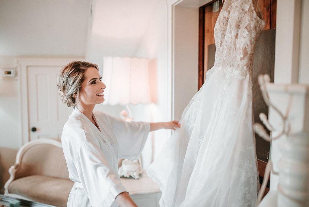 Bride looking at her wedding dress at Bluemont Vineyard