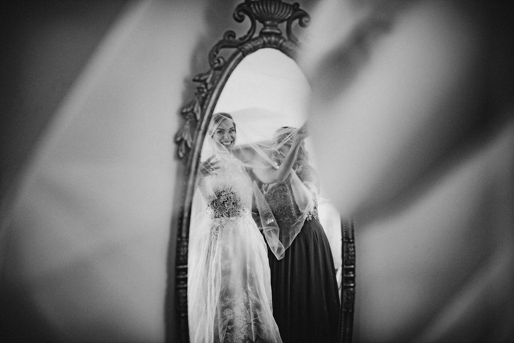 Bride looking in the mirror at Bluemont Vineyard