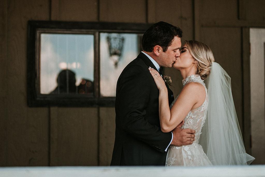 Bride and Groom Kissing at Bluemont Vineyard