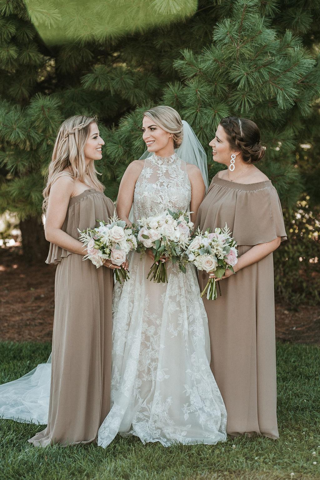 Bride Posing with Bridesmaids at Bluemont Vineyard