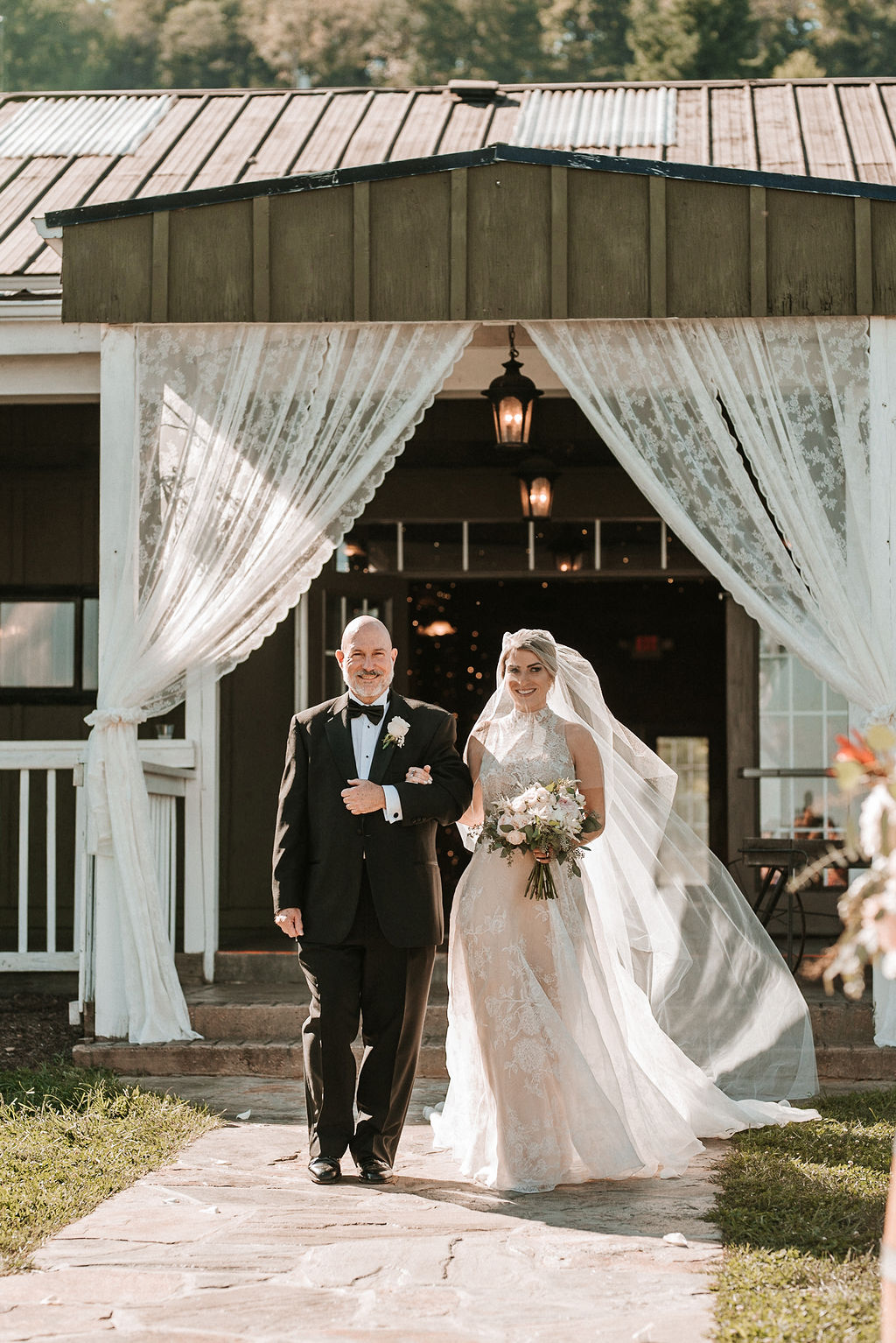 Bride Walking Down the Aisle with Father of the Bride at Bluemont Vineyard