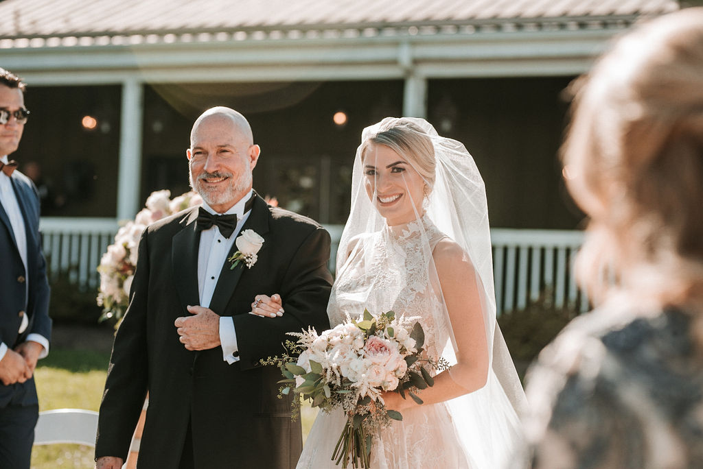 Bride and Father of the Bride walking down the aisle at Bluemont Vineyard