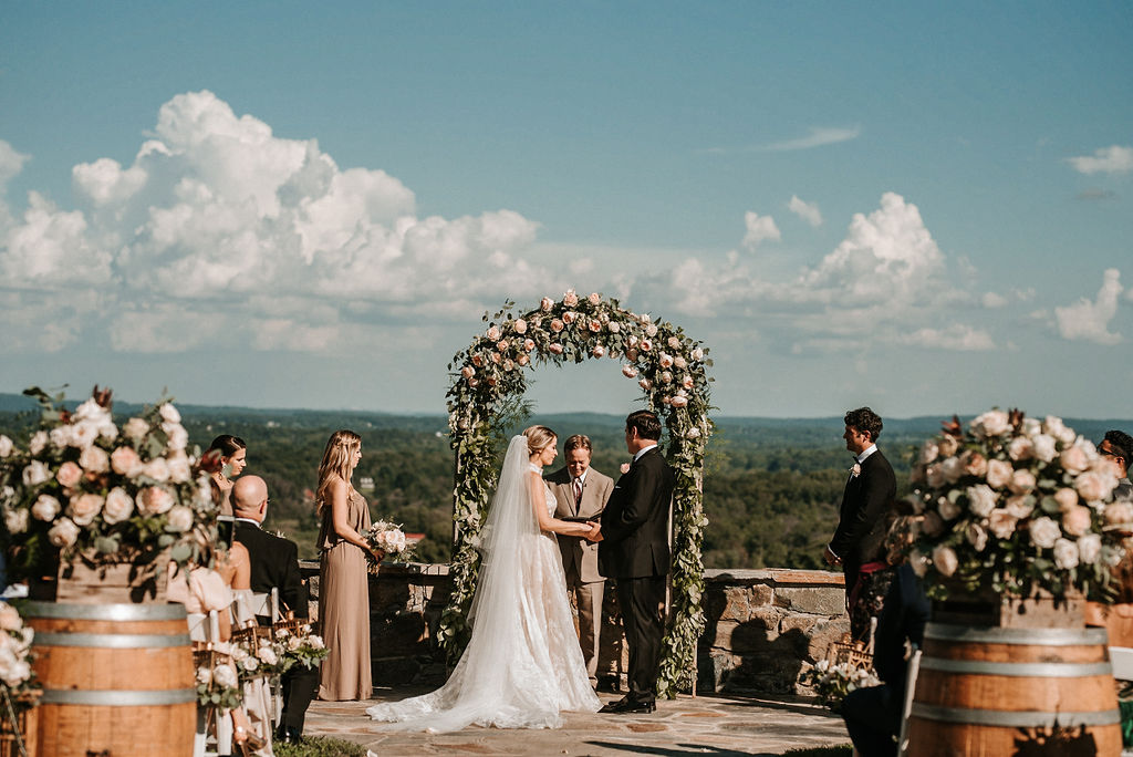 Bride and Groom standing at the alter at Bluemont Vineyard