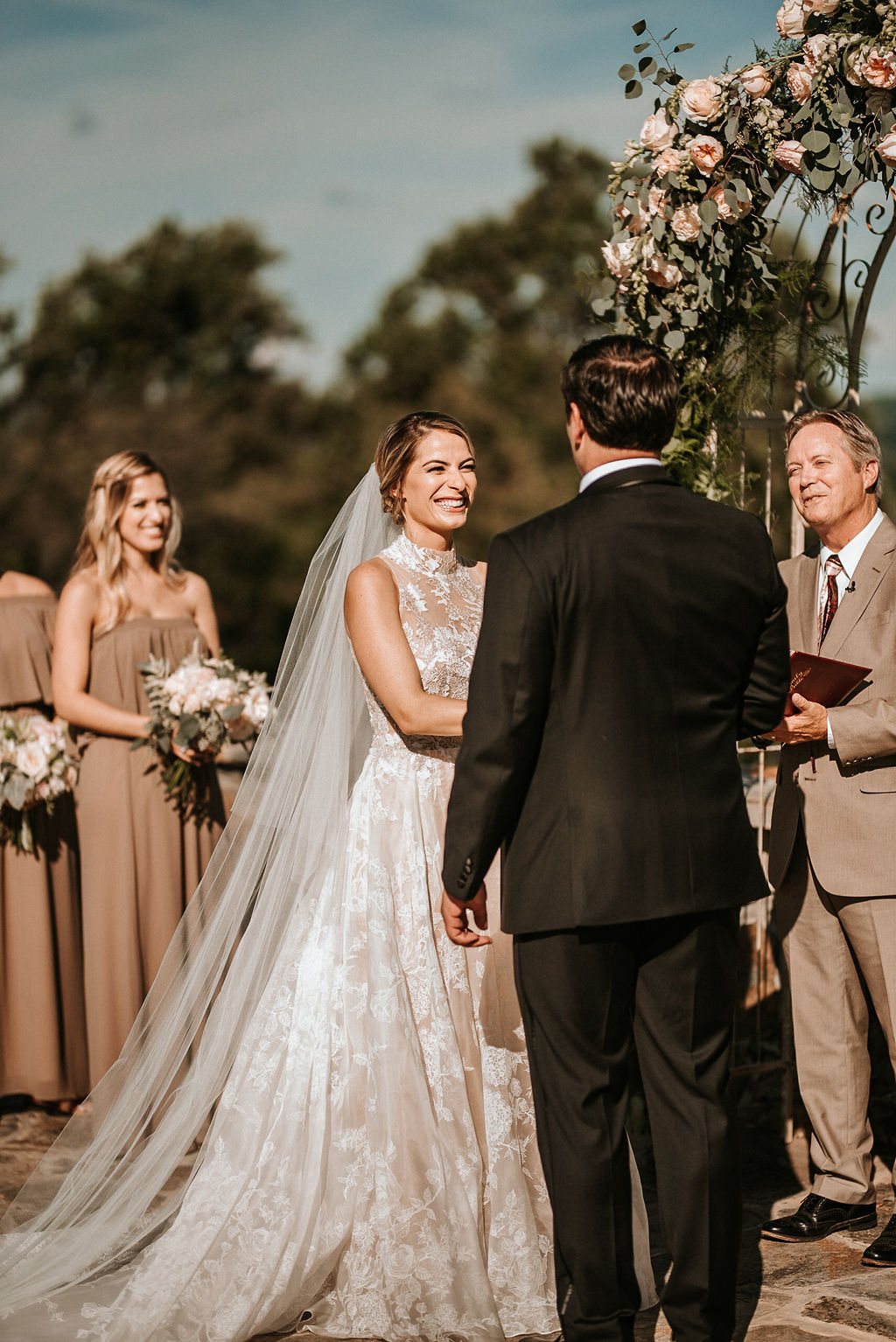 Bride smiling at the groom at the alter at Bluemont Vineyard