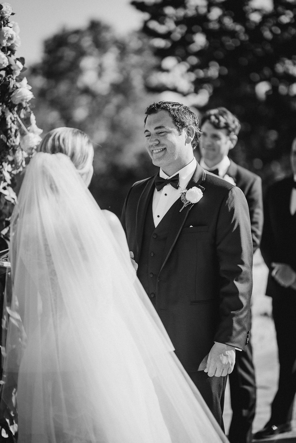 Groom Smiling at the Bride at the Alter at Bluemont Vineyard