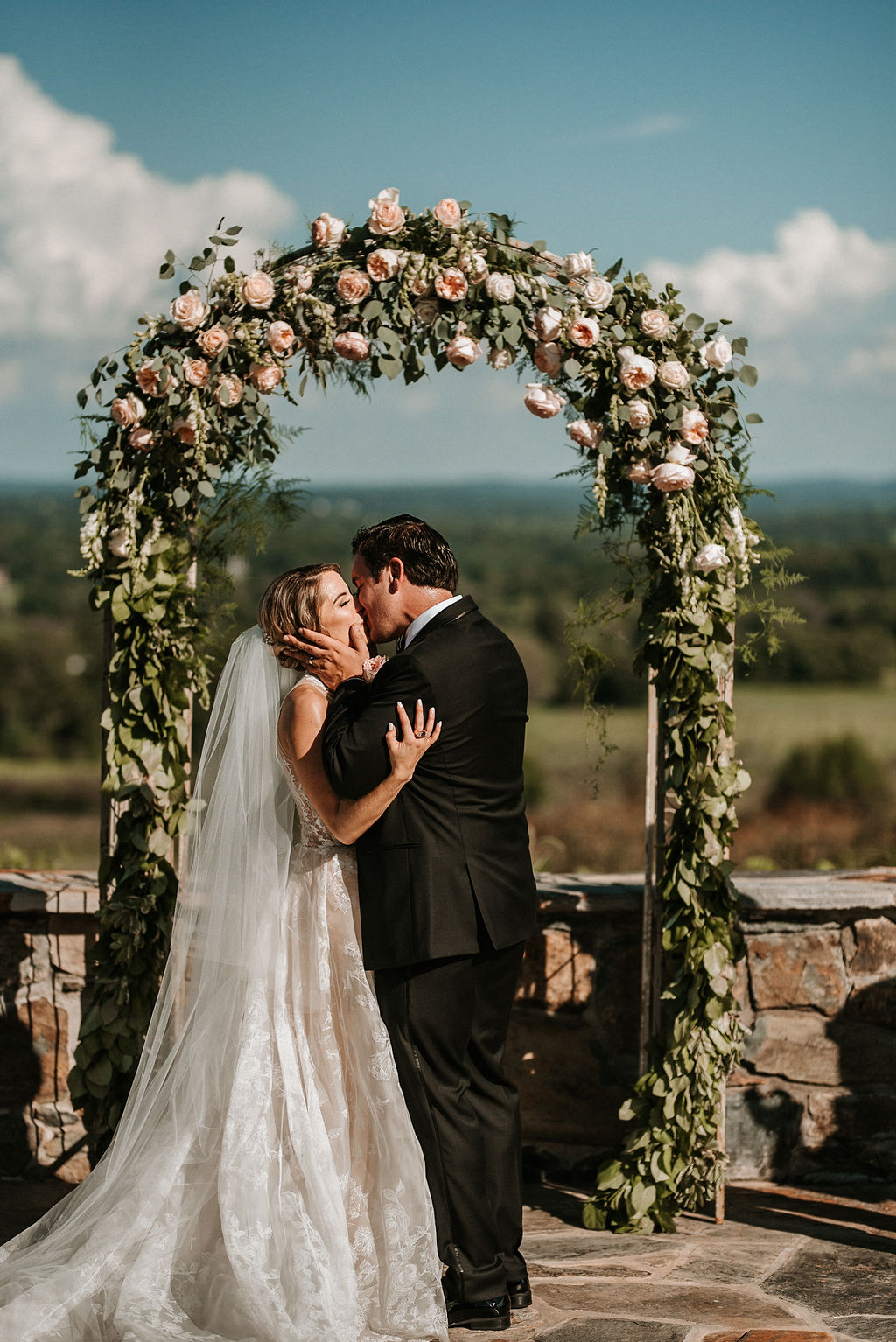 Bride and Groom Kissing at the Alter at Bluemont Vineyard