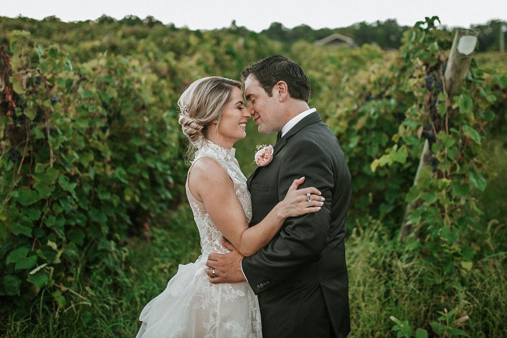 Bride and Groom Laughing at Embracing at Bluemont Vineyard