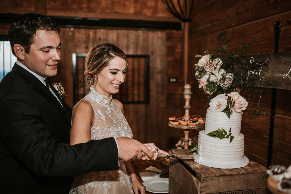 Bride and Groom Cutting Wedding Cake at Bluemont Vineyard