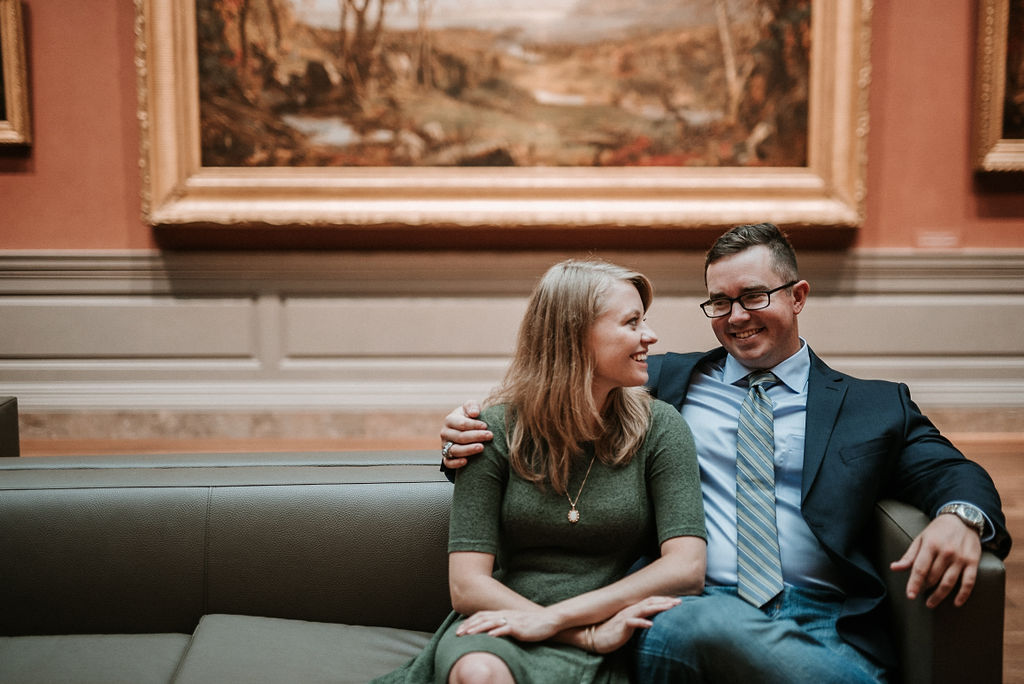 Couple smiling during engagement shoot at Smithsonian National Portrait Gallery