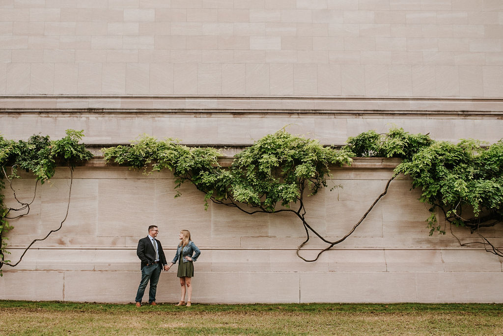 couple holding hands at during engagement session at Smithsonian National Portrait Gallery