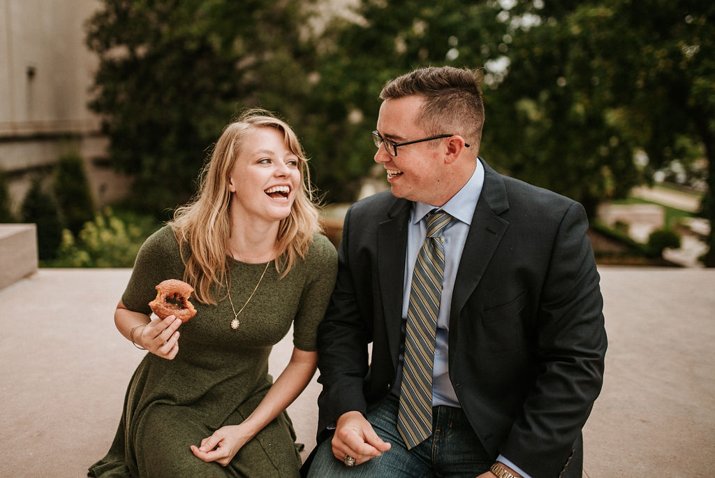 Couple laughing during engagement session at Smithsonian National Portrait Gallery