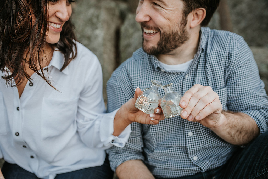 couple drinking tequila during engagement session at Great Falls National Park