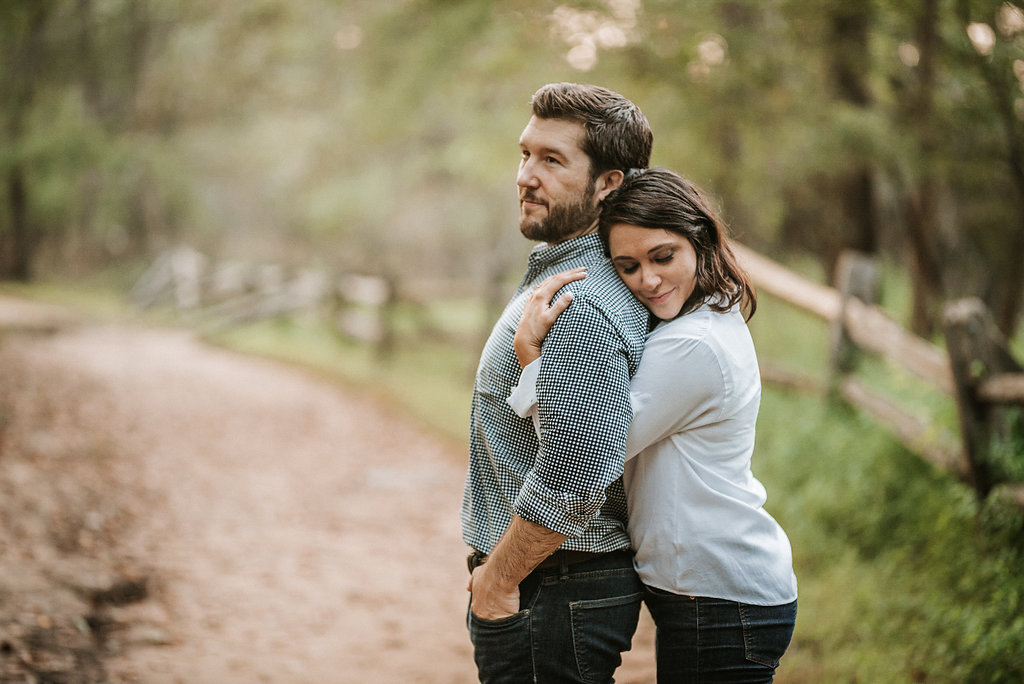 couple embracing during engagement session at Great Falls National Park