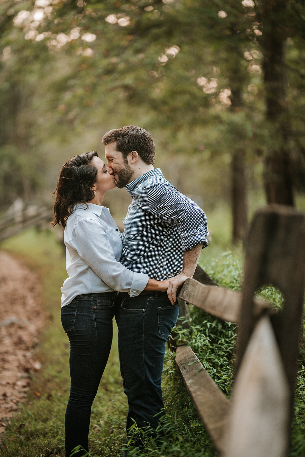 couple kissing during engagement session at Great Falls National Park