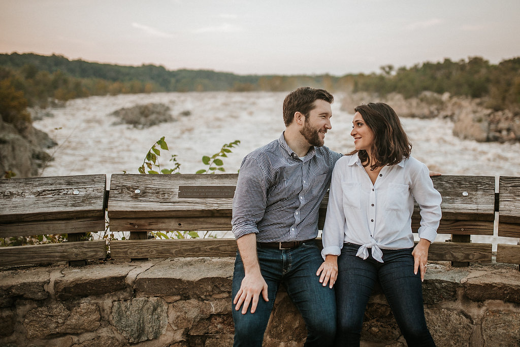 couple smiling during engagement session at Great Falls National Park