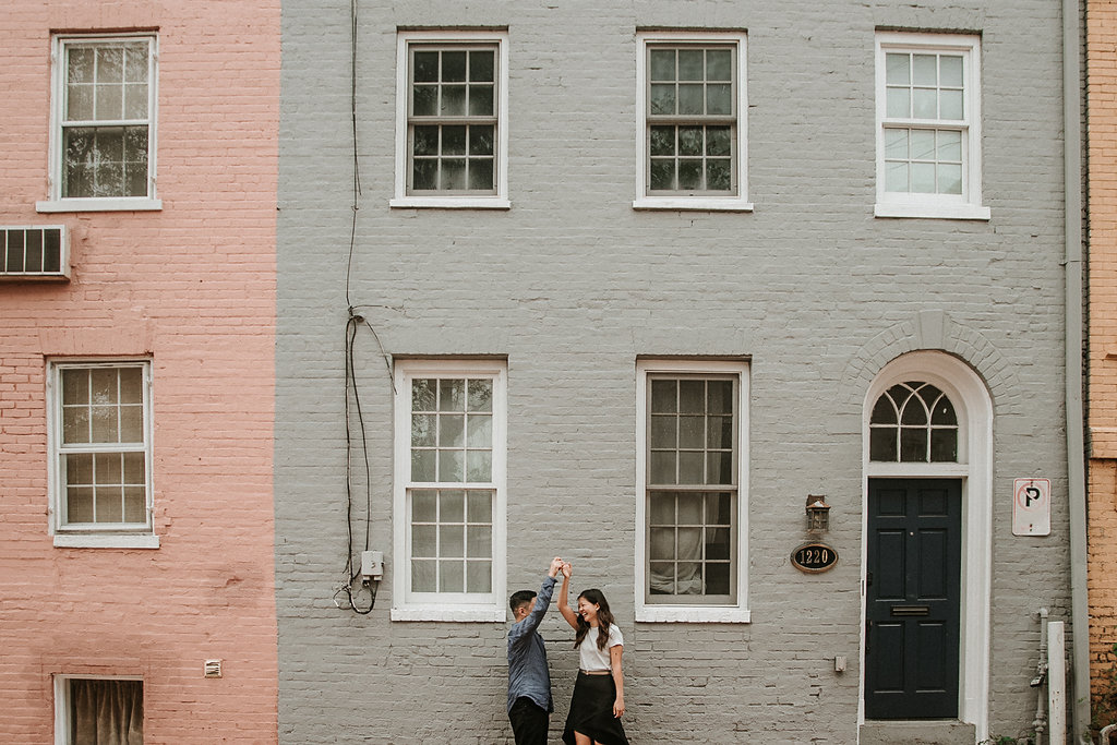 couple twirling during engagement session in Georgetown