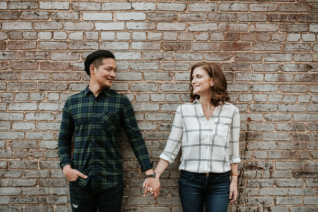 couple holding hands during engagement session at H Street in Washington DC