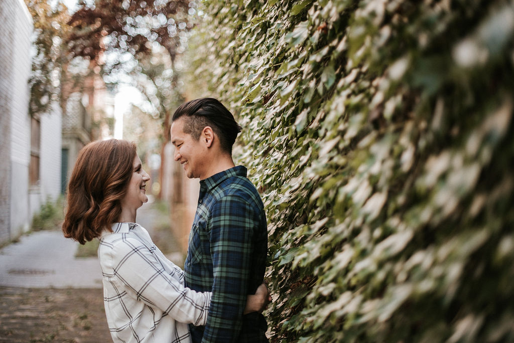 couple embracing during engagement session at H Street in Washington DC
