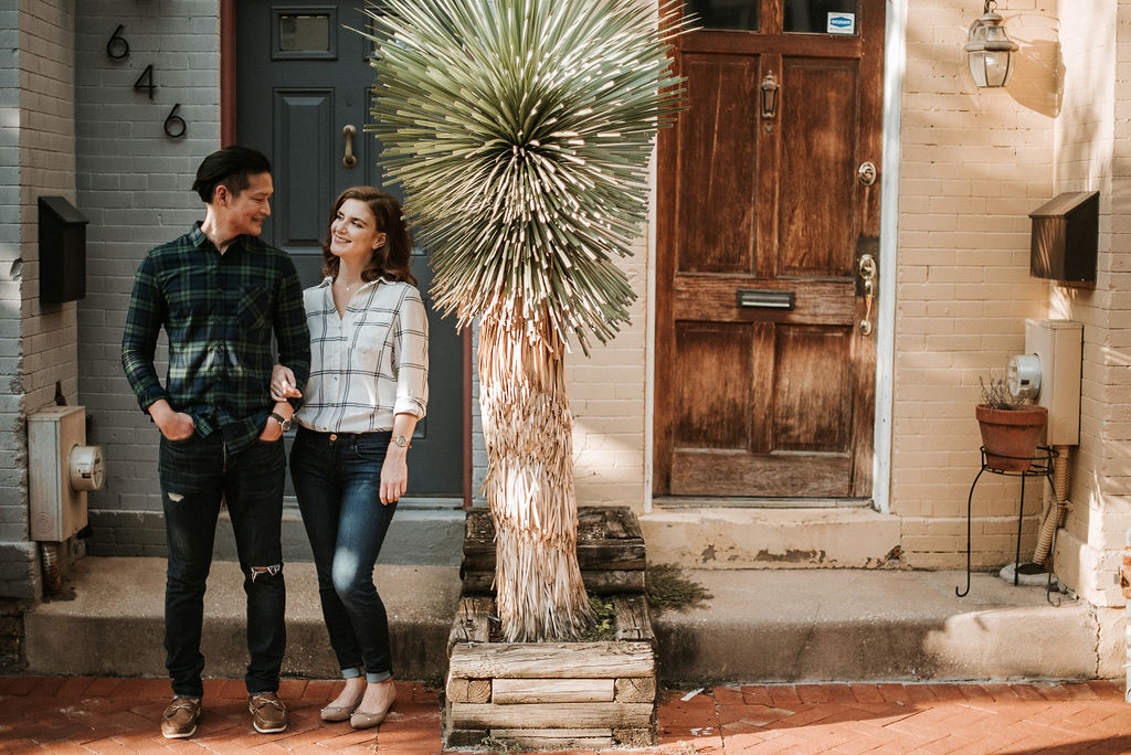 couple smiling during engagement session at H Street in Washington DC