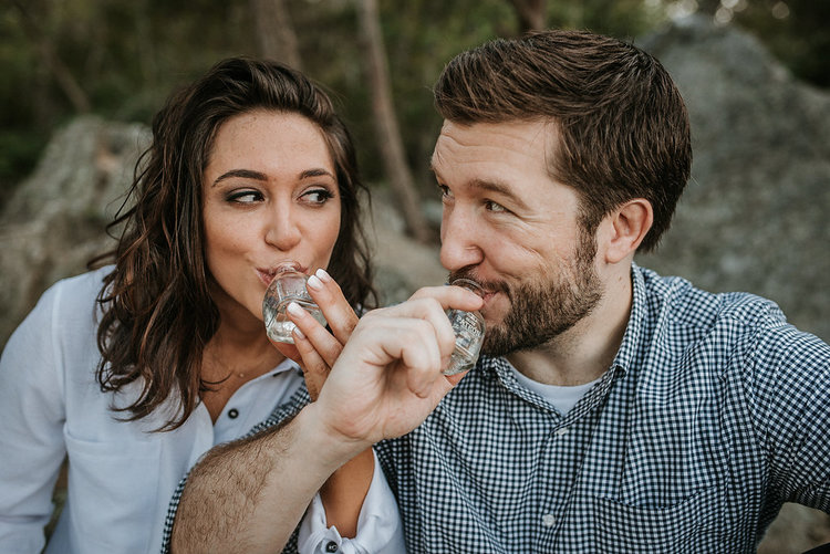 couple+drinking+tequila+during+engagement+session+at+Great+Falls+National+Park.jpeg