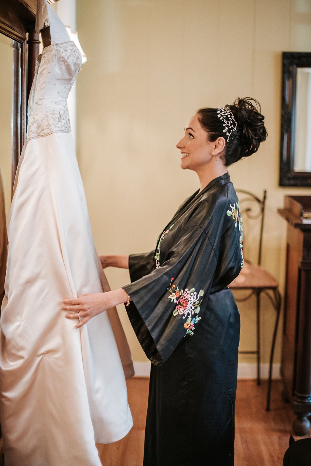 Bride admiring her dress at Inn at the Old Silk Mill
