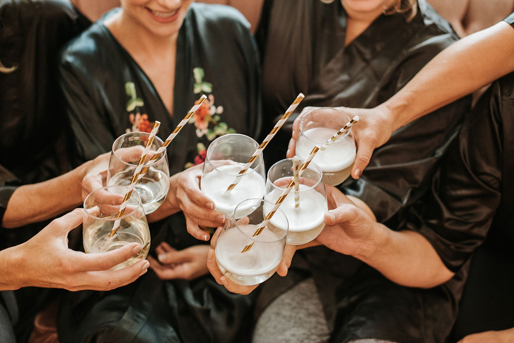 Bride and Bridal Party clinking drinks at Inn at the Old Silk Mill