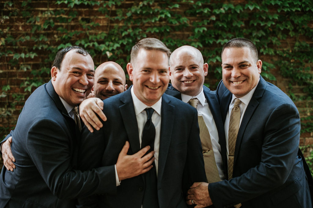 Groom and Groomsmen laughing at Inn at the Old Silk Mill