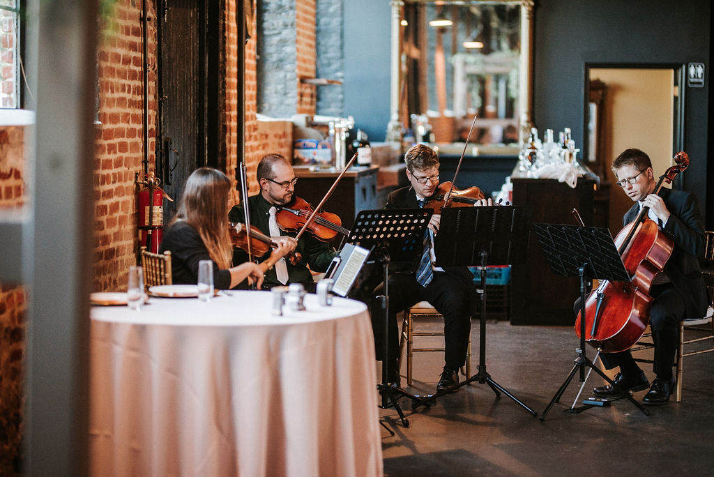 Orchestra playing at wedding ceremony at Inn at the Old Silk Mill