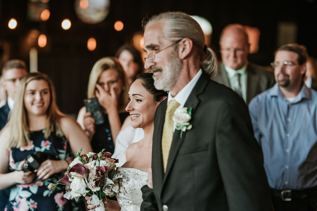 Bride walking down the aisle with father at Inn at the Old Silk Mill