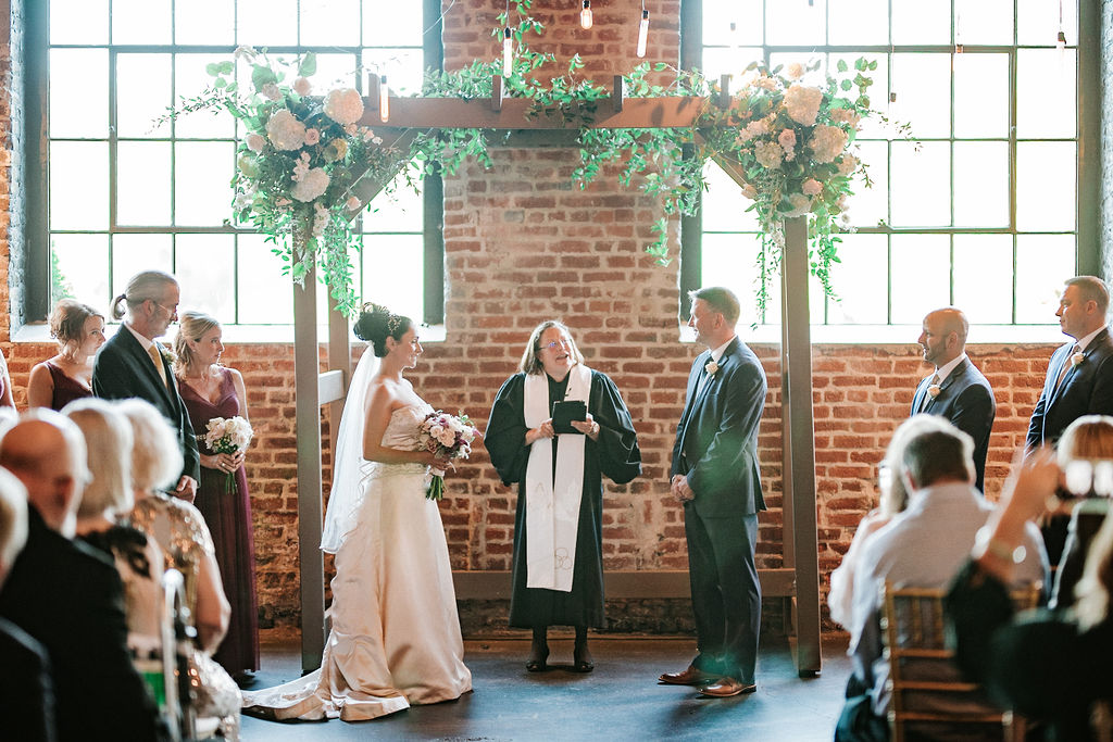 Bride and Groom at the alter at Inn at the Old Silk Mill