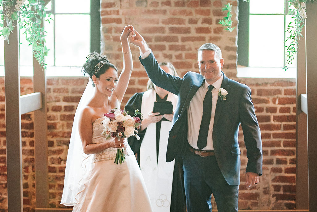 bride and groom cheering at Inn at the Old Silk Mill