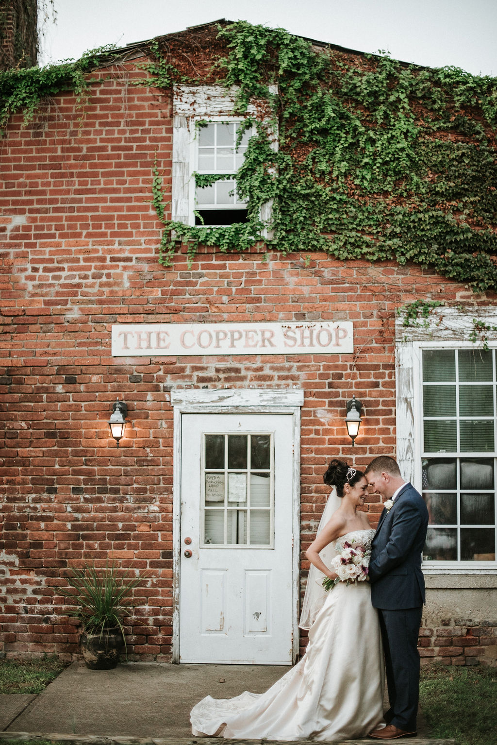 bride and groom gazing at each other at Inn at the Old Silk Mill