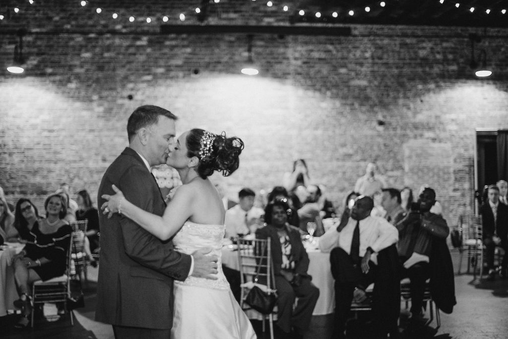 bride and groom kissing during first dance at Inn at the Old Silk Mill