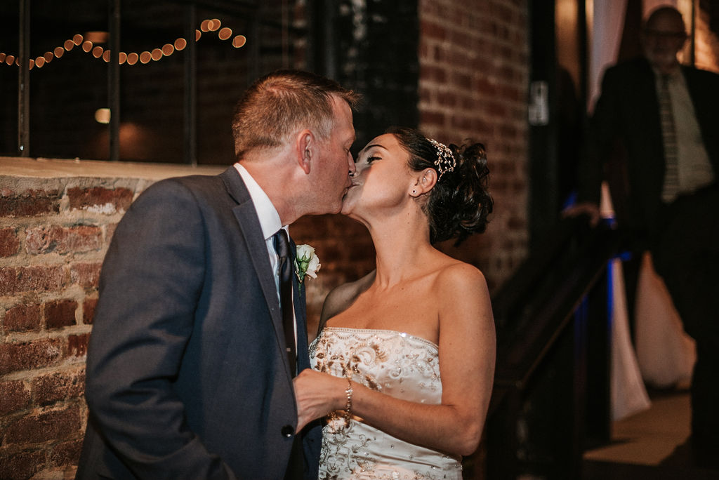 bride and groom kissing at Inn at the Old Silk Mill