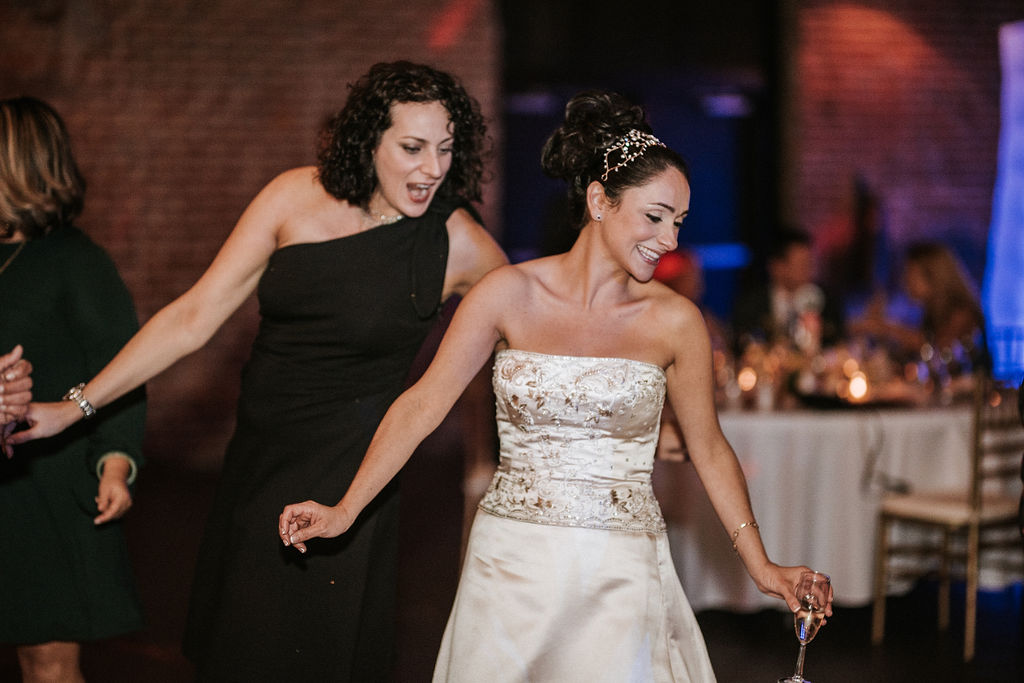 Bride and Guest Dancing during wedding reception at Inn at the Old Silk Mill