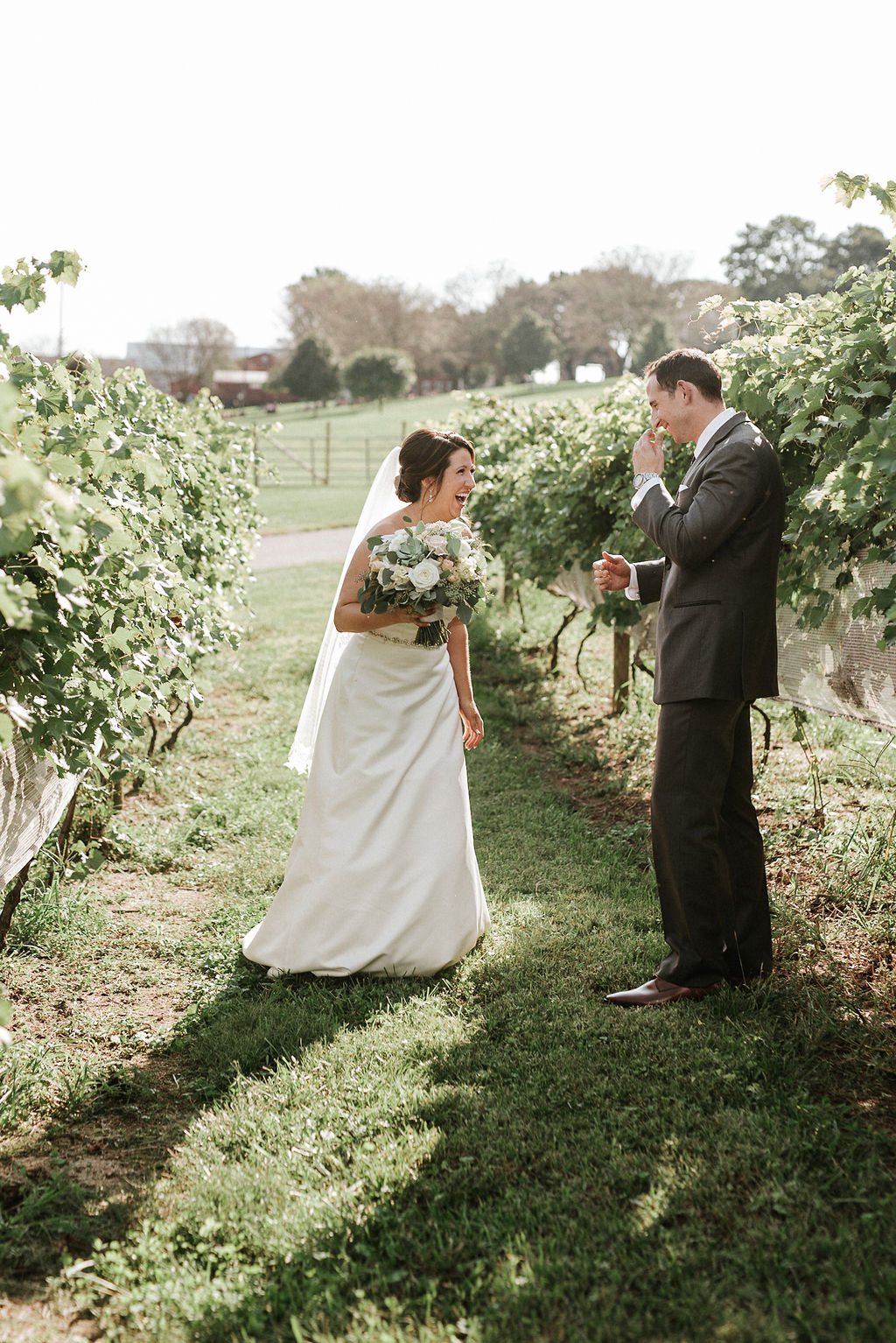bride and groom do a first look at Linganore Winecellars