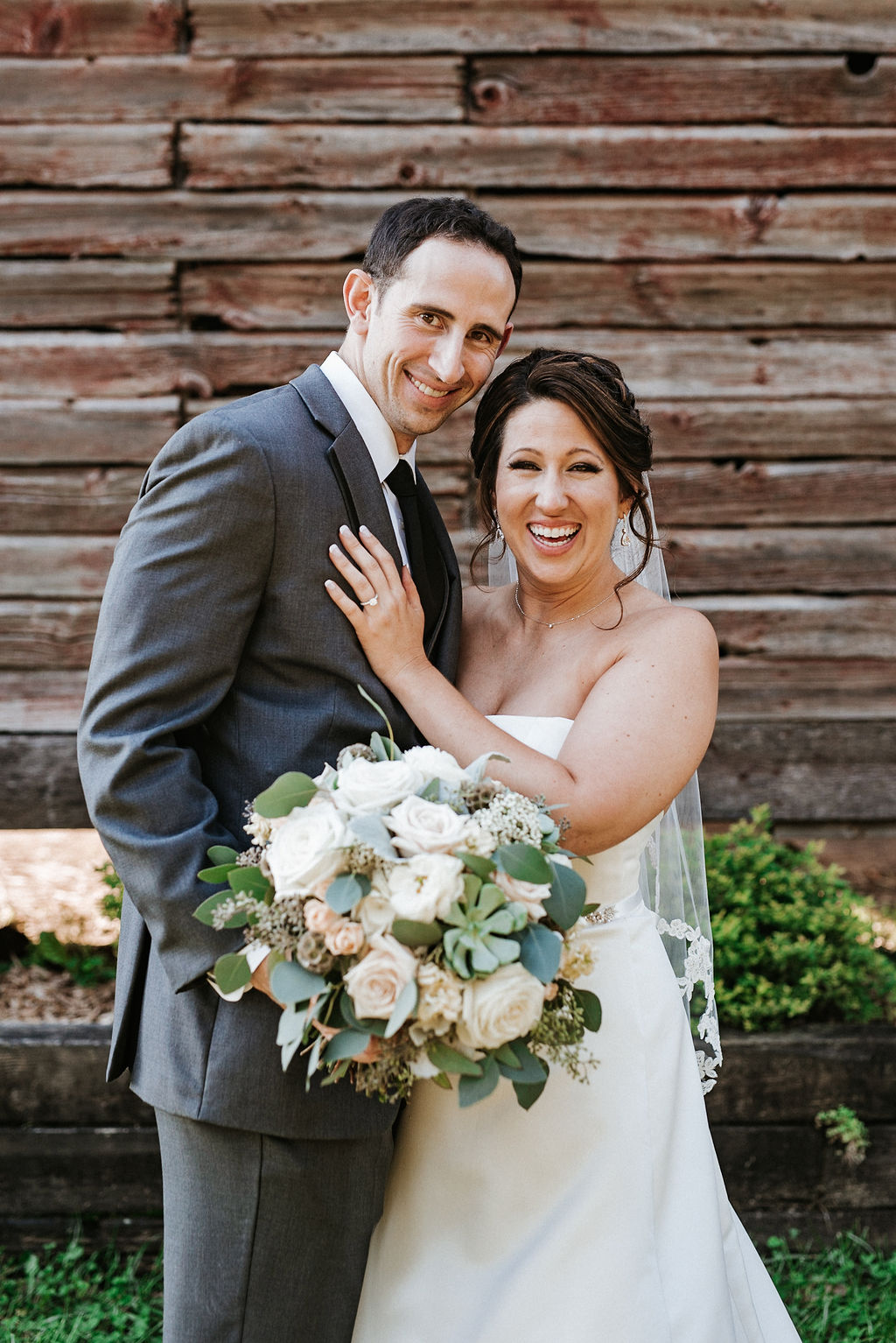 bride and groom smiling at Linganore Winecellars