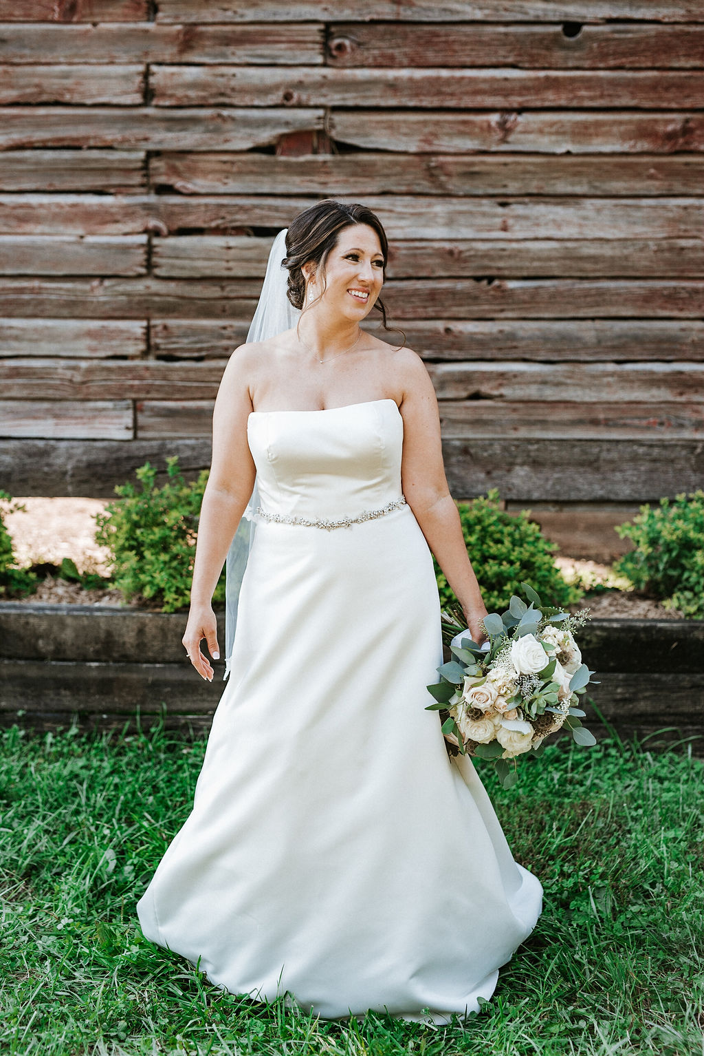 bridal portrait in front of barn at Linganore Winecellars