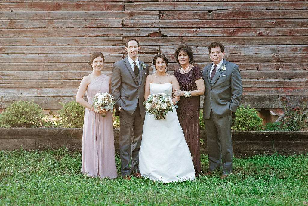 bride and groom posing with family at at Linganore Winecellars