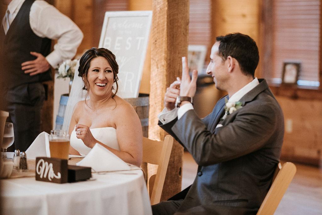 bride and groom laughing at reception at Linganore Winecellars