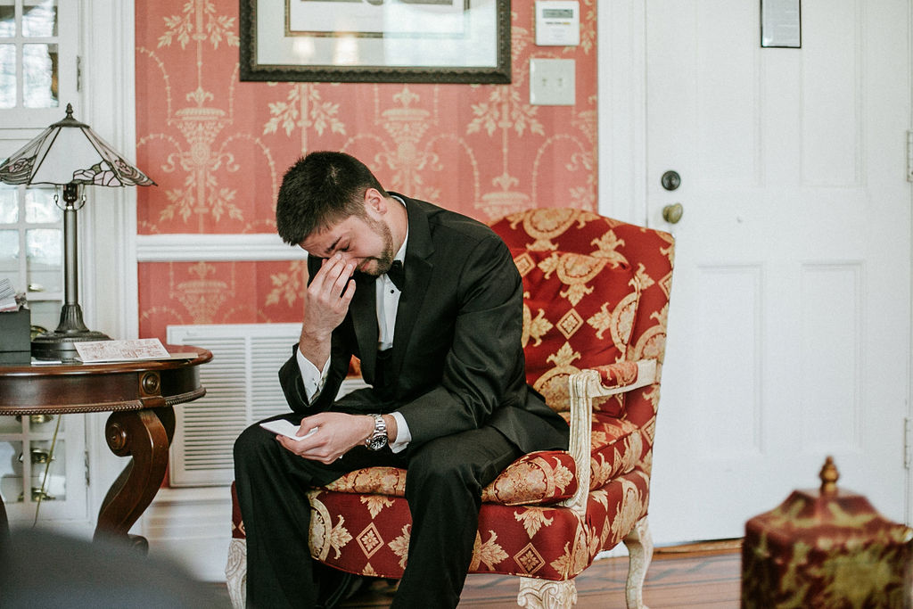 groom reading letter from bride at Historic Rosemont Manor